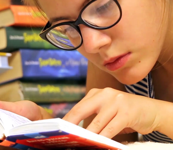 Girl Reading at Youth Haven Emergency Shelter | Youth Haven Naples, Florida