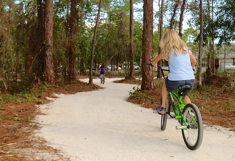 Girls riding bikes at Youth Haven emergency shelter for children and teens | Youth Haven SWFL
