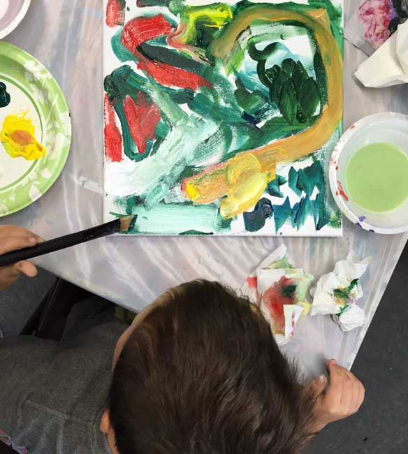 Young boy painting at Youth Haven Emergency Shelter for children and teens   Youth Haven Naples, Florida